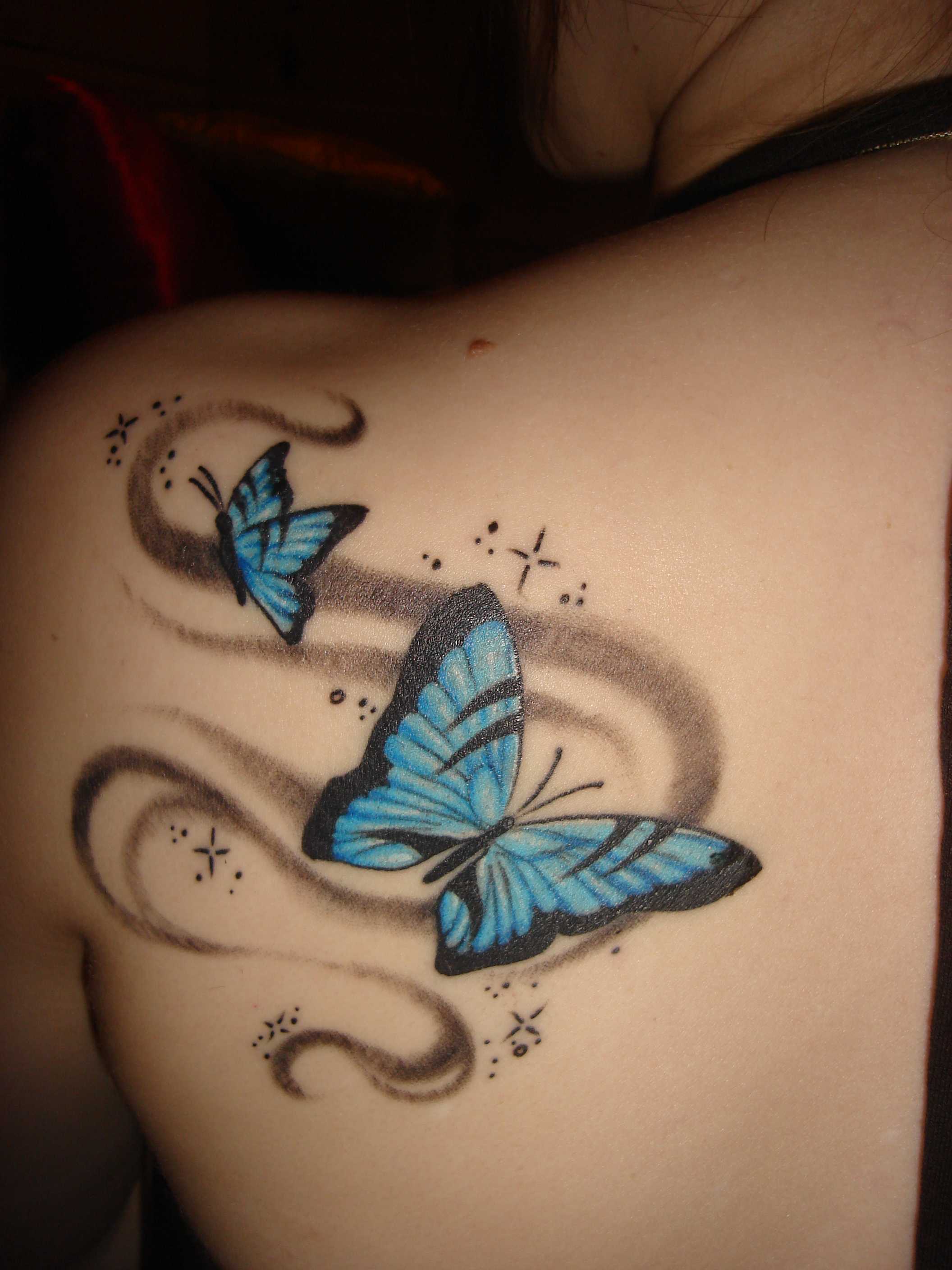 Butterfly tattoos femininity of butterflies roomfurnitures for Images of butterfly tattoos
